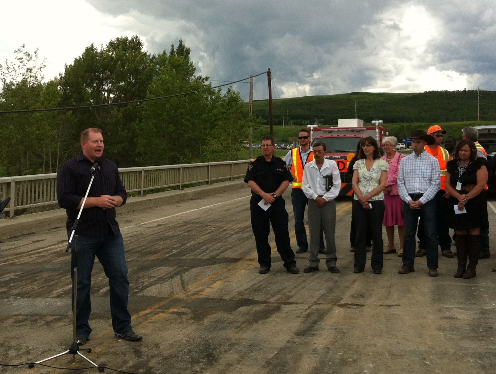 Associate Minister Kyle Fawcett speaks at bridge ceremony
