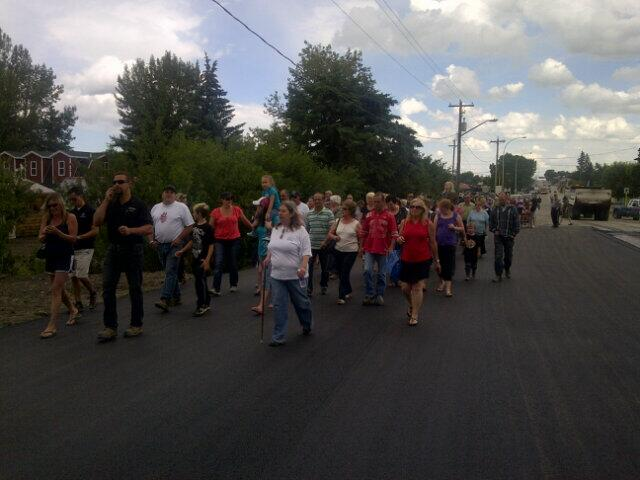 Residents walking to the bridge to participate in the ceremony